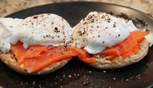 Wild caught smoked salmon with organic eggs on an english muffin.