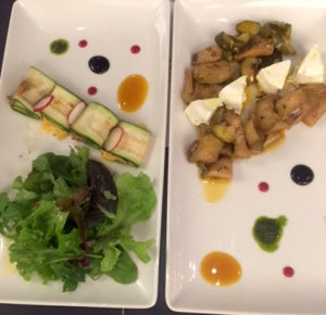 At the left, zucchini wrapped deliciousness. At the right, highly picked aubergine and zucchini with goat cheese.