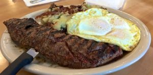 10oz Marinated Skit Steak, 3 eggs over easy with home fries from The Country Deli in Chatsworth.